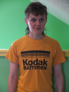 "a photo of a ""Kodak Batteries"" t-shirt"